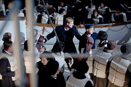 "Steven Waddington (center) as Second Officer Lightoller in ""Titanic."""