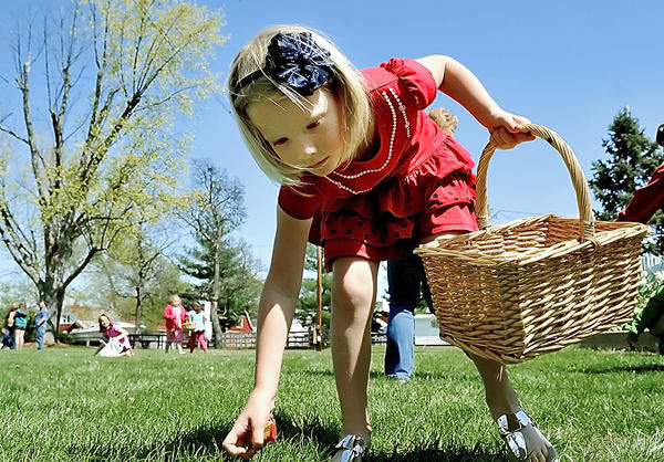 Anna Kate Davis, 7, of Boonsboro, collects candy at a candy scramble held at Boonsboro's Shafer Park.
