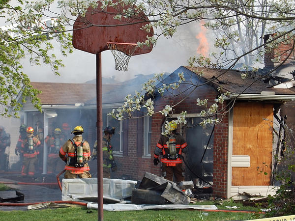 Flames can be see shooting through the roof of a home near Greencastle, Pa., that was destroyed by fire Sunday.