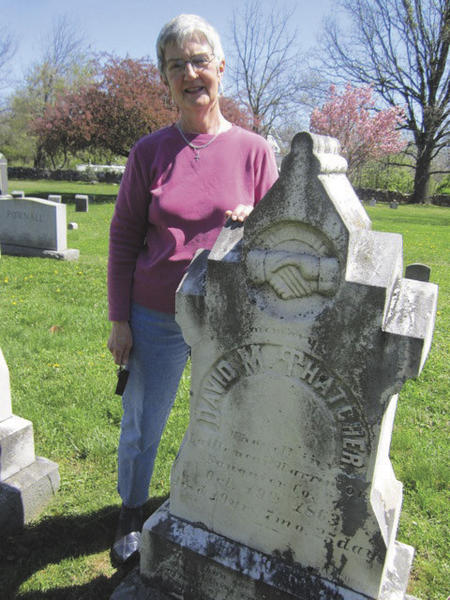 Karen Thatcher stands next to David Thatcher's gravestone in the family plot in the Tuscarora Presbyterian Church graveyard near Martinsburg, W.Va.