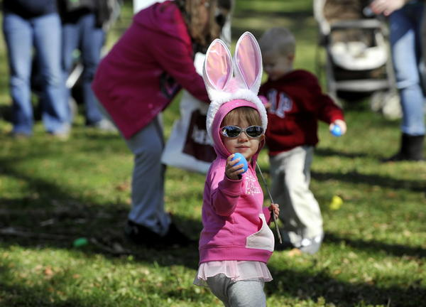 Isabella Bowen,  22 months, shows off one of the plastic eggs she found in the fields of Waterfowl Lake Pavilion at the Maryland Zoo in Baltimore. Bowen is on the hunt for Easter eggs during the annual Bunny BonanZOO.