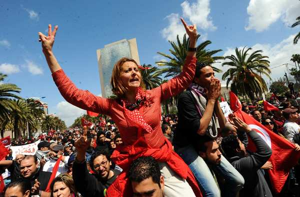 Tunisian doctor and human rights defender Amna Mnif, center, is  among the protesters who showed up Monday for a Martyrs' Day rally in Tunisia's capital Tunis, despite a ban on demonstrations there.
