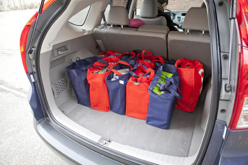 "Not all small crossovers are created equal. Witness <a href=""http://www.cars.com/honda/cr-v/2012/"" target=""_self"">the CR-V</a>, whose cargo area has 11 percent more maximum volume than the Chevrolet Equinox, despite the Honda being nearly 10 inches shorter. Folding the CR-V's seats couldn't be easier: pull a lever near the tailgate, and the seats flip forward. A covered center console can store a small shopping bag, too."
