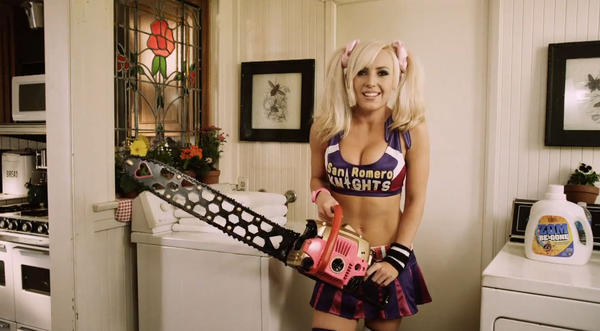 "This promotional model for the upcoming game ""Lollipop Chainsaw"" was outfitted somehow more appropriately than she is here and was allegedly asked to cover up if she was to remain on the PAX East convention floor."