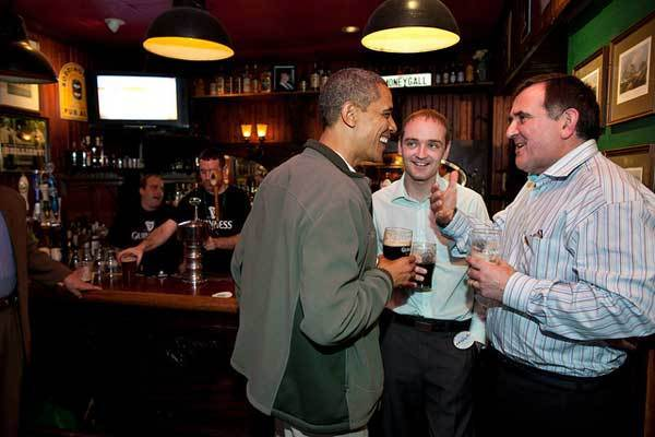 President Barack Obama visits the Dubliner, an Irish pub in Washington, D.C., with his Irish cousin, Henry Healy, center, and Ollie Hayes, a pub owner in Moneygall, Ireland, right, on St. Patrick's Day, Saturday, March 17, 2012.