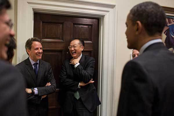 President Barack Obama talks with Treasury Secretary Timothy Geithner, Dr. Jim Yong Kim, and senior advisors in the Outer Oval Office prior to announcing Dr. Kim as his nominee to head the World Bank, March 23, 2012.