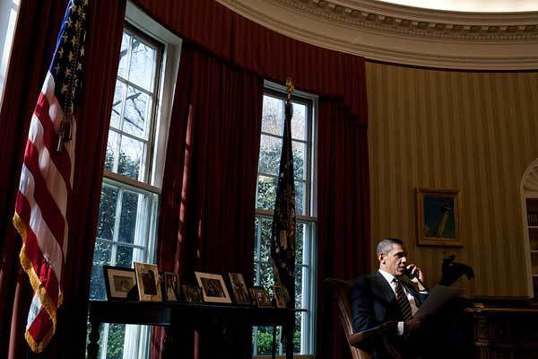 President Barack Obama talks on the phone with Palestinian Authority President Mahmoud Abbas in the Oval Office, March 19, 2012.