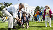 "WASHINGTON — A day after Americans said ""Let's Eat,"" First Lady Michelle Obama promoted the theme of ""Let's Go, Let's Play, Let's Move"" today during the annual White House Easter Egg Roll."