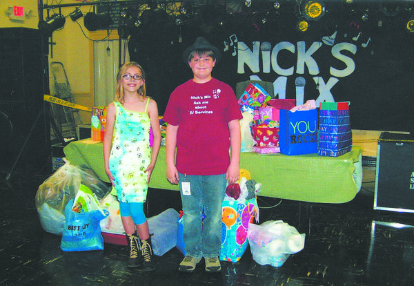 Becky Snyder, left, recently celebrated her birthday with a dance and a request for donations to the Humane Society of Washington County as gifts. Nick Vance, right, of Nick's Mix, donated his services as DJ. They are pictured with donated food and items for the animals.