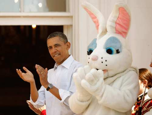 President Barack Obama gets into the action at the annual Easter Egg Roll on the South Lawn of the White House on Monday. Thousands attended the 134-year-old tradition.