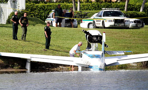 A plane makes an emergency landing in a lake at the Crystal Bay community west, of Delray Beach.