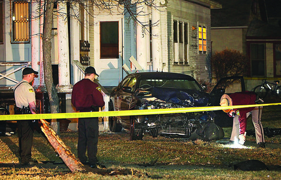 Investigators on the scene of the police car crash. American News Photo by John Davis