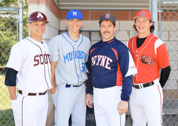 Three former Boyne City High School baseball standouts, Kolbi Shumaker (left), Caleb Roberts (second from left) and Dustin Field (right) pose with Boyne City coach Todd Shumaker. All three are 2011 Boyne graduates and freshmen on their respective college teams, Kolbi Shumaker at Alma, Roberts at Muskegon Community College, and Field at Davenport University. Kolbi Shumaker is a pitcher/third baseman; Roberts a pitcher; and Field an outfielder.
