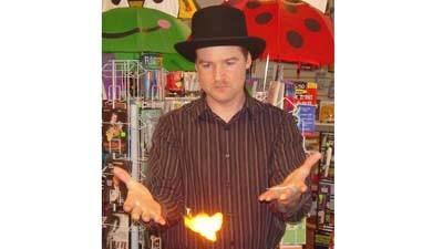 Assuming his Mr. Pep persona, Mr. Pep's Magic Shop owner Phillip Peurasaari performs a magic trick.