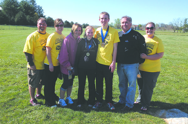 From left, Scott Myers, Jen Myers, Luann Myers, MacKenzie Riford, Luke Daigneault, Del. LeRoy Myers and Katie Myers are shown Saturday at the third annual Race for Ryan 6-K cross country race on the grounds of Grace Academy. The top finisher was Daigneault and the first female finisher was Riford.