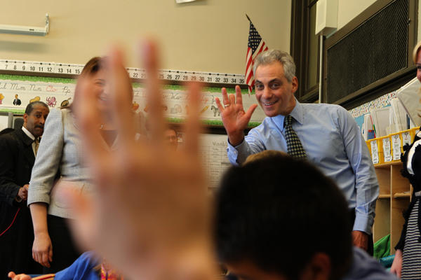 Mayor Rahm Emanuel, waving back at a third grade student who greeted him, today announced a compromise on a longer school day at Disney II Elementary Magnet School in Chicago.