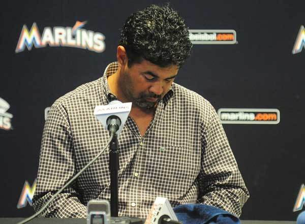 Miami Marlins Manager Ozzie Guillen listens to a question during a news conference Tuesday at Marlins Park in Miami. Guillen apologized for his remarks about Fidel Castro. Guillen had told Time magazine he loves Castro and respects the retired Cuban leader for staying in power so long. The Marlins suspended Guillen for five games.