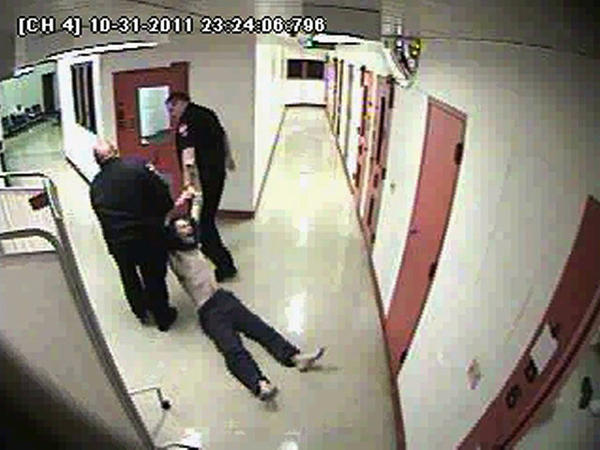 An image from security video provided by the Lake County state's attorney's office shows Eugene Gruber being forcibly removed from a holding cell.