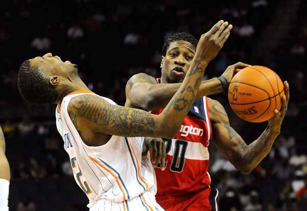 Washington Wizards forward Cartier Martin (20) runs into Charlotte Bobcats forward Tyrus Thomas (12) as he drives down the court.