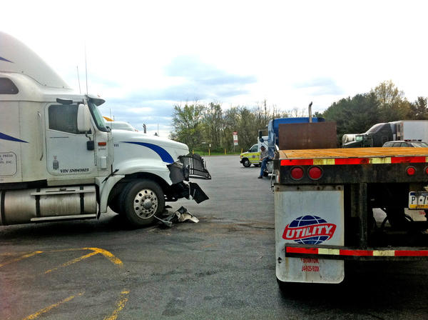 A damaged tractor-trailer, left, is seen in the parking lot of the Pilot Travel Center on Greencastle Pike following a collision Tuesday afternoon. One driver was taken to Meritus Medical Center.