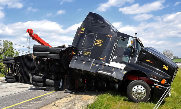 A tractor-trailer carrying rolls of newsprint paper overturned late Tuesday morning on southbound Interstate 81 near Chambersburg, Pa., blocking traffic for several hours.