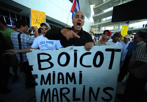 Adolofo Peraza Rico of Miami Cuban exile group Vigilai Mambisi prostests after Miami Marlins Manager Ozzie Guillen gave a news conference, Tuesday, April, 10, 2012, at Marlins Park in Miami. Guillen apologized for his remarks about Fidel Castro.