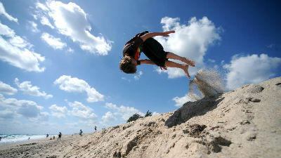 A boy does a flip on the beach at Singer Island. Expect a warm, almost hot day on Wednesday.