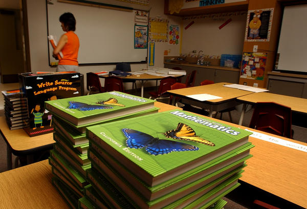 A teacher leaves her classroom headed for the copier machine with activities papers for first day of school at Canyon Vista Elementary School in Aliso Viejo.