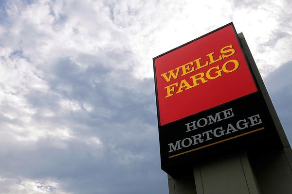 A Wells Fargo logo is displayed on a sign outside one of the company's office buildings in Springfield, Ill.