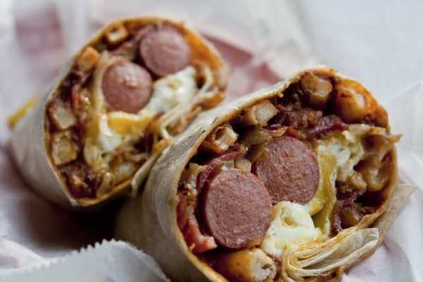 The U.S.A.: Still the greatest! This TNT Superdog from the Slaw Dogs in Pasadena blows away Pizza Hut's new hot-dog-stuffed-crust pizza that people in Britain can now enjoy.