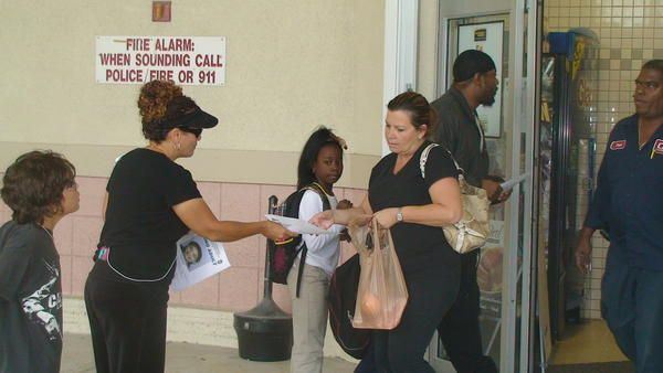 Family and friends distribute flyers at Miramar shopping centers to find missing mother Vilet Torrez.
