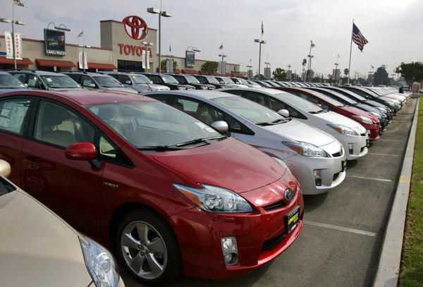 Prices for used cars such as these Toyota Prius hybrids are rising rapidly.