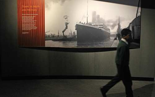 A schoolboy walks past a Titanic display at the Ulster Folk & Transport Museum in Belfast, Northern Ireland. Two exhibitions at the museum focus on the construction and the human side of the saga of the famed ocean liner, which hit an iceberg and sank on its maiden voyage in 1912.