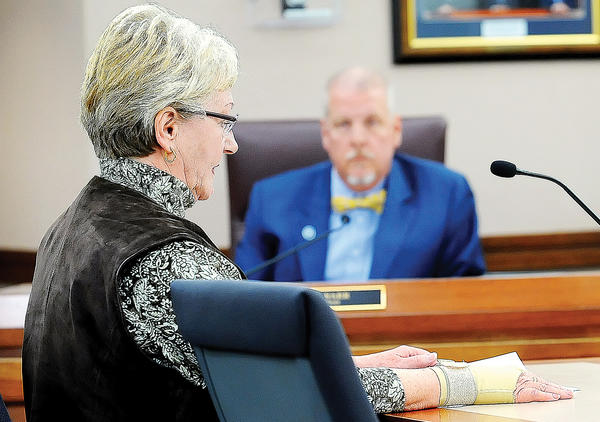Barbara Hovermill, of Williamsport, tells the Washington County Commissioners Tuesday that she opposes allowing noncounty residents to serve in local government. County Commissioner John Barr listens.