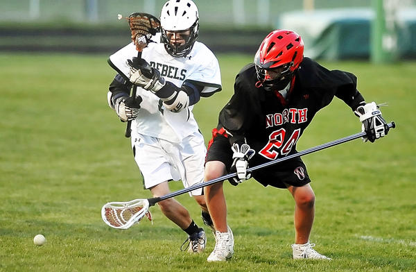 South Hagerstown's Isaac O'Brien, left, and North Hagerstown's Orin Keel scramble for a loose ball during Tuesday night's MVAL Antietam boys lacrosse game at School Stadium.