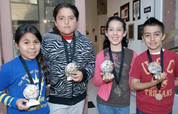 Winners in the kindergarten through grade five category were, from left, Precious Romero, Melissa Orozco, Isabella Hedman and Kristian Solano.