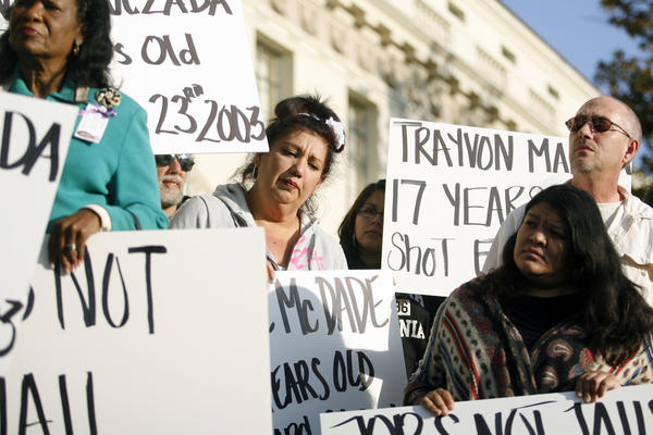 Samantha Ramirez, from third left, and others attend a rally, which was held in front of City Hall in Pasadena on Tuesday, April 10, 2012. NAACP organized the rally in response to the Kendrec McDade shooting.