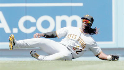 Pittsburgh Pirates center fielder Andrew McCutchen can't hang one to a ball hit by Los Angeles Dodgers' Juan Uribe during the second inning of a baseball game in Los Angeles, Tuesday. Uribe was credited with a single on the play.