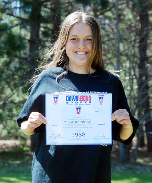 Boyne Falls High School junior Erica Westbrook displays her first round selection certificate to the 2012 Down Under Sports All-American Cross Country 5K Challenge, which will take place in June in Gold Coast, Australia.