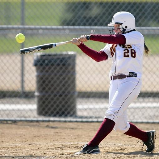 Northern State University's Eryn Yancy connects with a pitch during Tuesday's first game against the University of Sioux Falls at Moccasin Creek Softball Complex. photo by john davis taken 4/10/2012