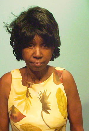 Sharon Burton, 56, of the 3600 block of West Franklin Boulevard, has been charged with fatally stabbing her daughter's boyfriend during an argument, police said.