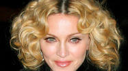 "Forget heart. <strong><a class=""name"" href=""http://www.eonline.com/celebs/Madonna/113986"">Madonna</a></strong> would probably like fans to open their wallets."