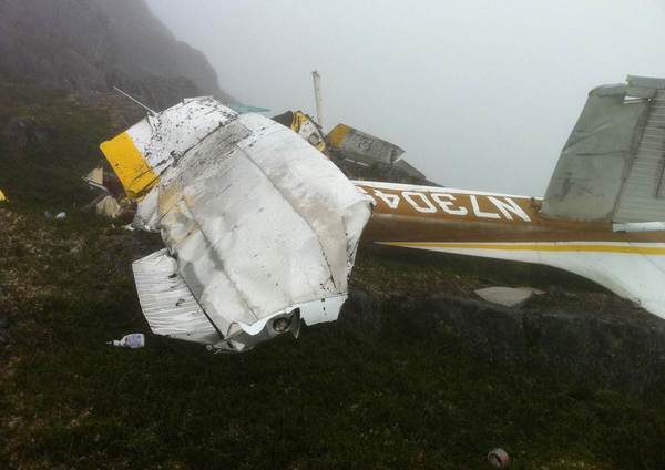 Photos released by the National Transportation Safety Board show the wreckage of a crashed Cessna 182 small plane on a mountain slope last summer near Juneau, Alaska. Charles Luck, 77, and his wife, 51-year-old Liping Tang-Luck, were flying from Hoonah to Juneau when they were killed in the July 24 accident.