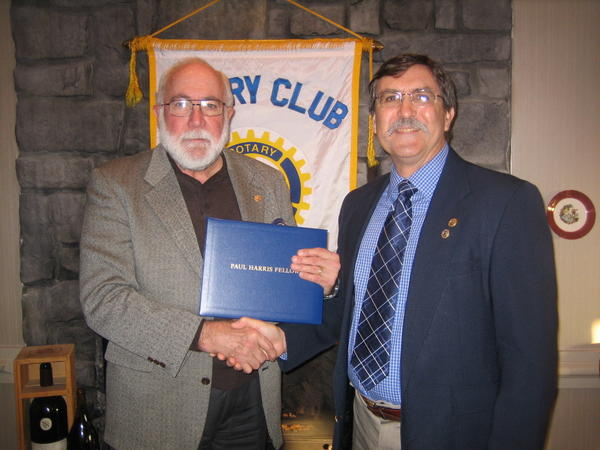 Doug Alexander, right, receives the Paul Harris Award from Tom Trumble.