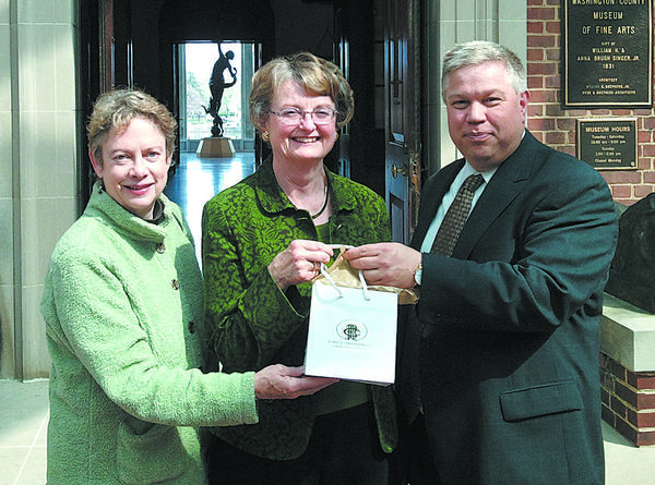 Diane Sanford, center, of Hagerstown, with board of advisors member Dale Stein, and Bradley Pingrey, president, board of trustees. Sanford won a $5,000 shopping spree at R. Bruce Carson Jewelers.