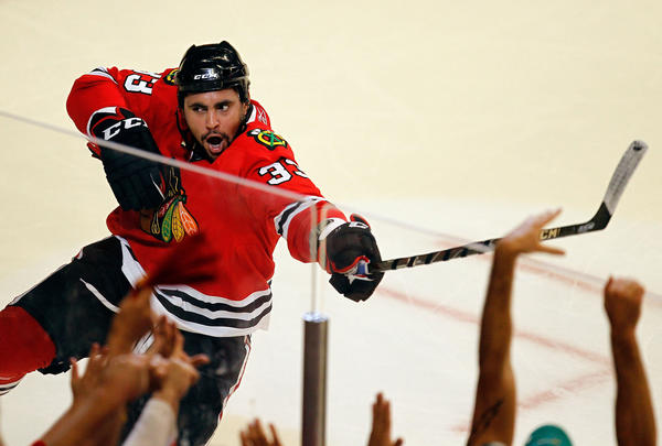 Dustin Byfuglien strikes his famous pose after scoring a goal against San Jose in Game 4 of the Western Conference Semifinals in 2010. Big Buff broke a tie with 5:55 left to complete the sweep of the Sharks and send the Hawks to the Finals.
