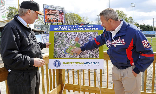Maryland Comptroller Peter Franchot, left, listens to Hagerstown Mayor Robert Bruchey II explain where a proposed site of a new stadium would be during Franchot's visit Wednesday to a Hagerstown Suns game at Municipal Stadium.