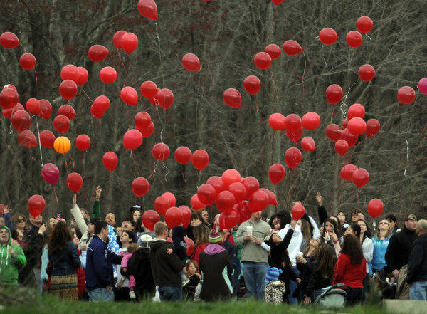 Close to 100 Salem residents gathered on the field of the Salem School with red balloons to hold a brief memorial service for six year old Jeffrey Bourgeois who was killed in a tragic accident on Tuesday. At the count of three, the group released the red balloons and watched them soar into the sky.