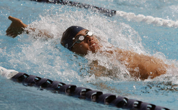 Pasadena Poly's Chandler Woo does a backstroke during a swim meet at Flintridge Prep in La Canada on Wednesday, April 11, 2012.
