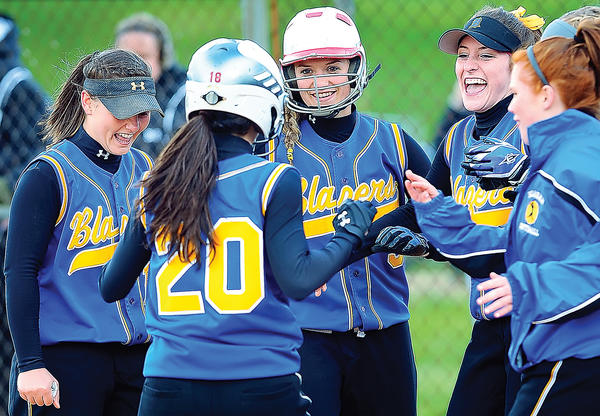 Clear Spring's Lexi Albert (20) is greeted at home plate by teammates, including Heather Schlotterbeck, far left, and Jenna Knable, center, during Wednesday's MVAL Antietam softball game against Smithsburg.